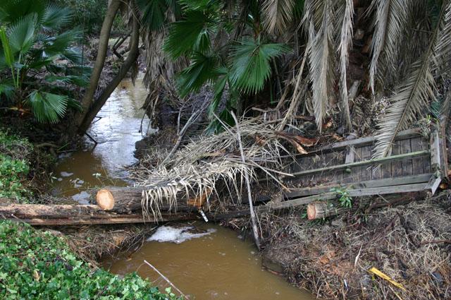 1000 pound broken bridge washed downstream like a toothpick creates log jam.